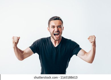 Happy winner man with fists up celebrating success
