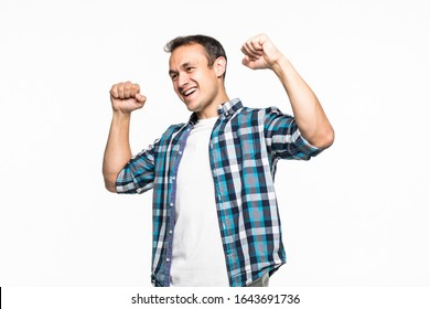 Happy winner. Happy young handsome man gesturing and keeping mouth open while standing against white background