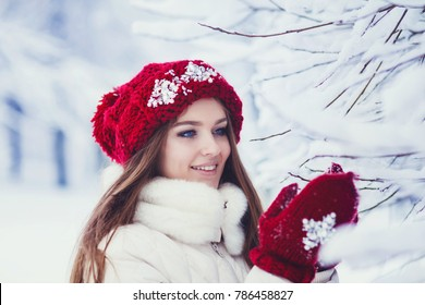 Happy winter women in park snow