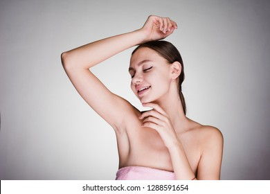 happy woman after shower on gray background