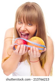 happy woman with apple and grapefruit and  tape measure for diet , over white