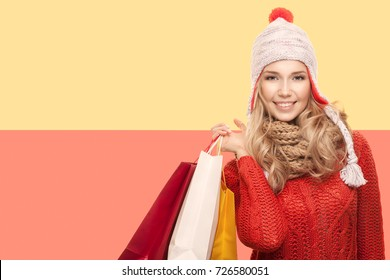 Happy woman with bags. Winter sale.