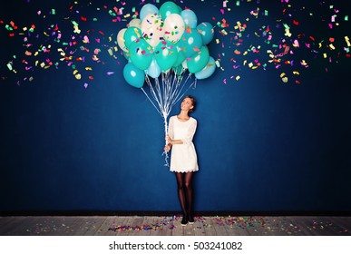 Happy Woman, Balloons and Confetti on Blue Banner Background with Copy Space