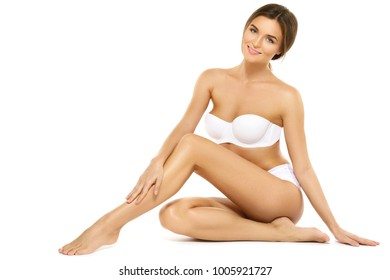 Happy woman with a beautiful body isolated on white background