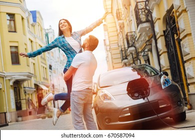 Happy woman being lifted up by her boyfriend