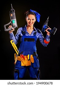 Happy woman builder with construction tools.