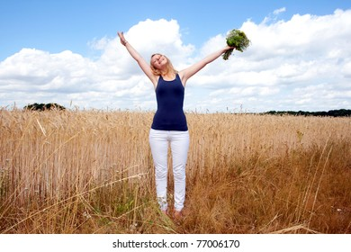 Happy woman with a bunch of flowers