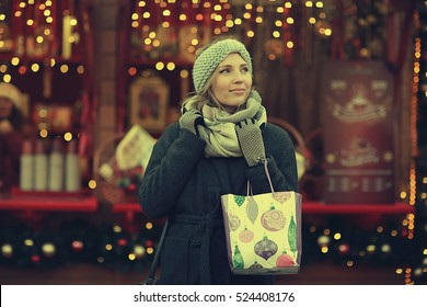 happy woman buys gifts for the new year