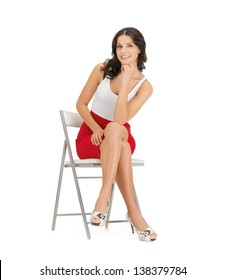 happy woman in casual clothes sitting in chair
