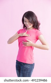 Happy Woman check her chest, prevent breast cancer concept
