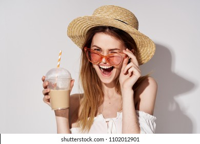 happy woman with a cocktail in her hand