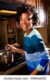 Happy woman cooking in a kitchen.