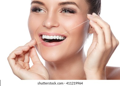 Happy woman and dental floss on white background