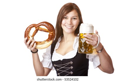 Happy woman in dirndl dloth holding Oktoberfest beer stein and pretzel in hands. Isolated on white.