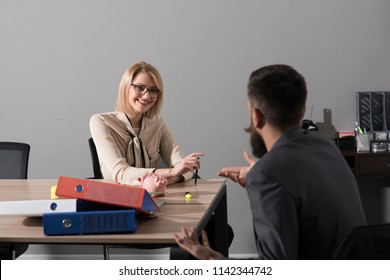 Happy woman discuss company money with man. Woman boss smile with financier in office. Businesswoman and manager at work process. Business and finance concept. Piggy bank savings and handout.