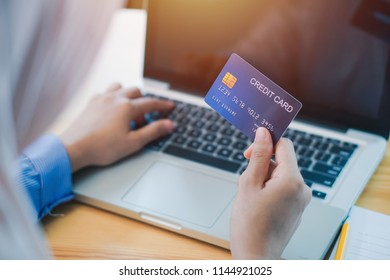 Happy woman doing on line shopping at home. portrait of happy woman purchasing product via online shopping. pay using credit card