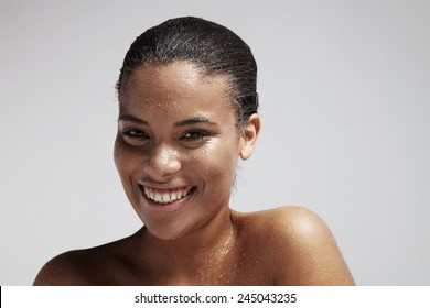 happy woman with a drops of a water on her skin