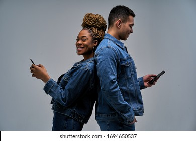 Happy woman in earrings with bun of braids looks at the camera with man with smile