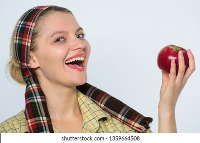 Happy woman eating apple. orchard, gardener girl with apple basket. vitamin and dieting food. organic and vegetarian. healthy teeth. spring harvest. summer fruit. Vitamins are important for health.