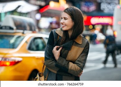 Happy woman enjoy the walk on winter time on New York City street and doing Christmas shopping