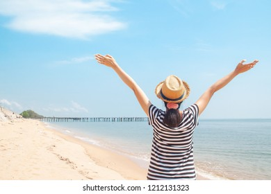 Happy woman enjoying at the beach, Holiday travel concept