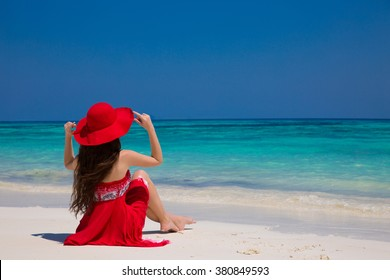 Happy woman enjoying beach relaxing joyful on white sand in summer by tropical blue water. Bliss freedom beach concept. Good life. Vacation.