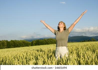 Happy woman in the field.