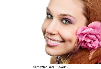 Happy woman with flower at ear isolated on white background