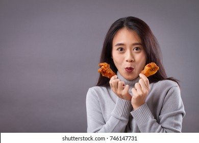 happy woman with fried chicken