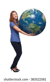 Happy woman in full length holding earth globe in her hands, American continent in front, over white background