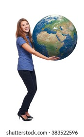 Happy woman in full length holding earth globe in her hands, Africa and Europe in front, over white background