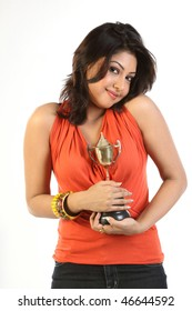 Happy woman with gold trophy
