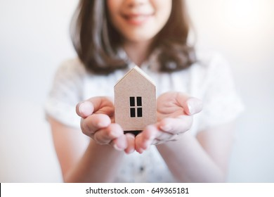 Happy woman hands holding paper house close up , Real estate concept ,Home loan