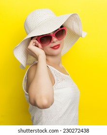 Happy woman in hat and sun glasses