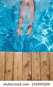 Happy woman having fun on summer vacation. Girl jumping in swimming pool. Active healthy lifestyle concept. Spring break!