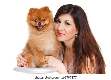 Happy woman and her beautiful little red dog spitz over white background close portrait