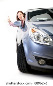 happy woman with her new car - thumbs up - isolated over white