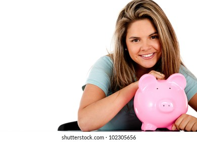 Happy woman with her savings in a piggy bank ���� isolated
