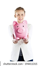 Happy woman with her savings in a piggy bank isolated on white background
