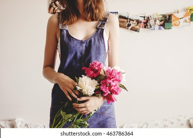 happy woman hipster holding peony bouquet close-up in the morning, sweet romantic moment , space for text