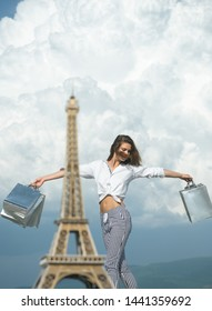 happy woman hold shopping bag. successful shopping. sense of freedom. parisian girl travel to france. eiffel tower. fashion week. present packages. holiday. summer fashion. spring. Catching moment.