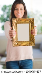Happy Woman Holding Blank Picture Frame