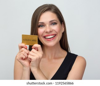 Happy woman holding credit card on white background. Close up portrait.
