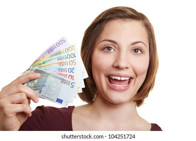 Happy woman holding fan of Euro money bills