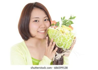 Happy woman holding a flower bouquet