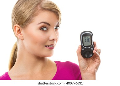 Happy woman holding glucose meter with positive result of measurement sugar level, concept of diabetes, checking and measuring sugar level