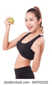Happy woman holding green apple in hand and showing thumb up.