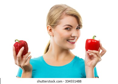 Happy woman holding in hand fresh and old wrinkled peppers, healthy and unhealthy food, white background