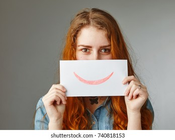 happy woman holding picture with drawn smile