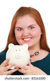 A happy woman holding a piggy bank